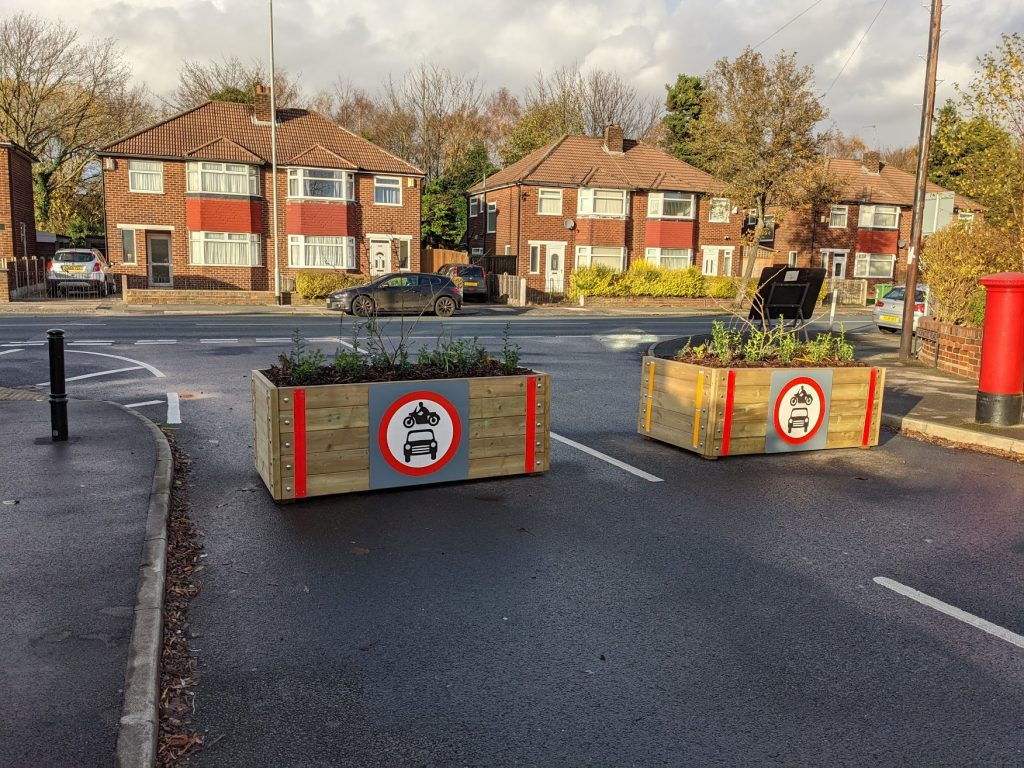 Shows two planters forming a modal filter in a low traffic neighbourhood in Longford Park, Stretford